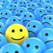Happy smiley between sad ones — Stock Photo