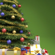 Stock Photo: Christmas tree with presents detail on green