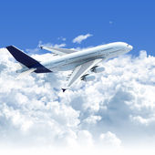 Airplane flying over the clouds side top view — Stock Photo