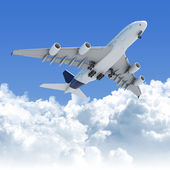 Airplane flying over the clouds after takeoff — Stock Photo