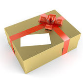Golden gift with white label — Stock Photo