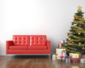 Red couch and xmas tree — Stock Photo