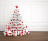 White and red christmas tree in empty room — Stock Photo