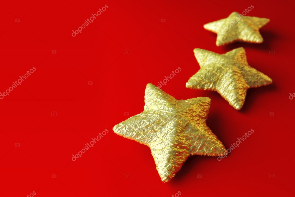 Three golden stars on red background, christmas theme for background or compositing — Stock Photo #8198941