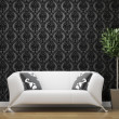 White sofa on black and silver wallpaper — Stock Photo