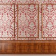 Red wallpaper and wood molding — Stock Photo