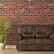 Stock Photo: Leather couch on brick wall