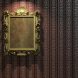 Golden frame on classic wallpaper - Stock Photo