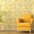 Interior with armchair and flowery wallpaper - Stock Photo