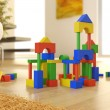 Construction blocks on a modern interior — Stock Photo