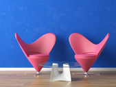 Pink seats on blue wall — Stock Photo