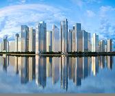 Skyscraper skyline reflected on water — Stock Photo