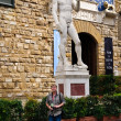 Tourist at the Statue of David, Florence, Italy - Stock Photo