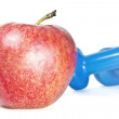 Blue dumbbells and a red apple on a white background — Stock Photo