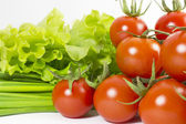 Cherry tomatoes, salad and chives — Stock Photo