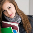 Shy young brunette student girl. — Stock Photo #10384739