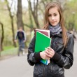 Cool fashionable young student girl outdoors. — Stock Photo #10384741