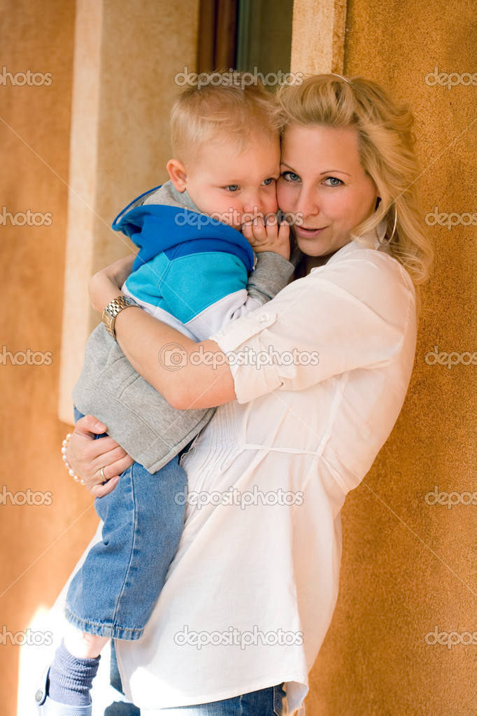 Portrait of a fashionable young mother with her cute son.  Stock Photo #10393707