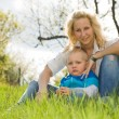 Attractive mom and her son outdoors. — Stock Photo #10522379