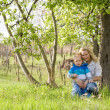 Cute kid with his mom outdoors in nature. — Stock Photo #10522399
