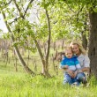 Cute kid with his mom outdoors in nature. — Stock Photo