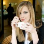 Elegant young blond woman on cofffee break. — Stock Photo #10590927