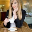 Elegant young blond woman on cofffee break. — Stock Photo