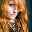 Flirty, moody portrait of a beautiful young redhead girl. — Stock Photo