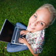 Stock fotografie: Gorgeous young blond having fun with laptop outdoors