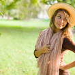 Fresh young brunette posing in nature. — Stock Photo