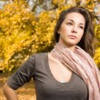 Beautiful autumn with beautiful brunette. — Stockfoto