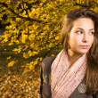Beautiful autumn with beautiful brunette. — Stock Photo