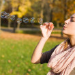 Blowing bubbles into the wind. — Stock Photo #8185118