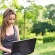 Outdoors with her laptop. — Stock Photo #8187002