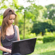 Outdoors with her laptop. — Stock Photo