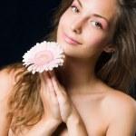 Beauty shot of gorgeous brunette holding flower. — Stock Photo #8187965