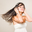 Gorgoeus young brunette immersed in music. — Stock Photo