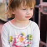 Charming baby toddler girl having fun. — Stock Photo