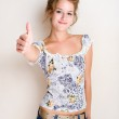 Cheerful young blond woman thumbs up. — Stock Photo #8189046