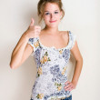 Cheerful young blond woman thumbs up. — Stock Photo #8189057