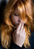 Moody dark portrait of a young redhead girl. — Stock Photo