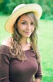 Beautiful young spring brunette enyjoying nature. — Stock Photo