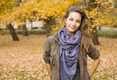 Beautiful autumn with beautiful brunette. — Stock Photo