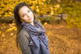 Autumn park and a beautiful brunette. — Stock Photo