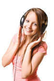 Sweet brunette with listening to music — Stock Photo