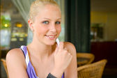 Cute young blond girl with her mobile phone. — Stock Photo