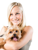 Attractive young blond woman and her dog. — Stock Photo