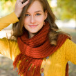 Colorful fall fashion girl in the park. — Stock Photo