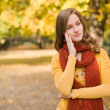 Stock Photo: Fall fashion girl pondering.