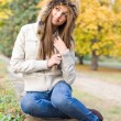 Cuteness in fur hat. - Stock Photo
